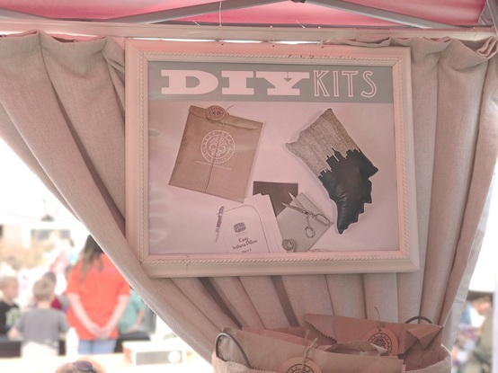 using signs in your craft show booth to draw attention