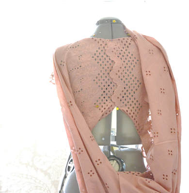 draping eyelet fabric on a dress form